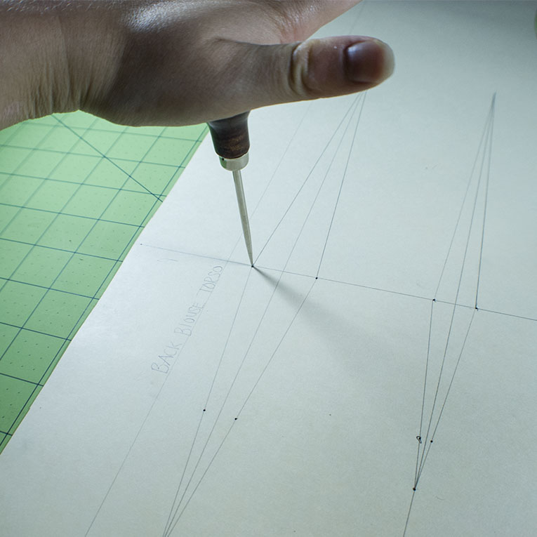 Sewing Hack-Use an awl to punch a hole in your pattern | www.isntthatsew.org